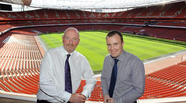 Alan Davison, managing director of Portview Fit-Out and Angus Kinnear, marketing director at Arsenal FC, celebrate completion of the premium tier project