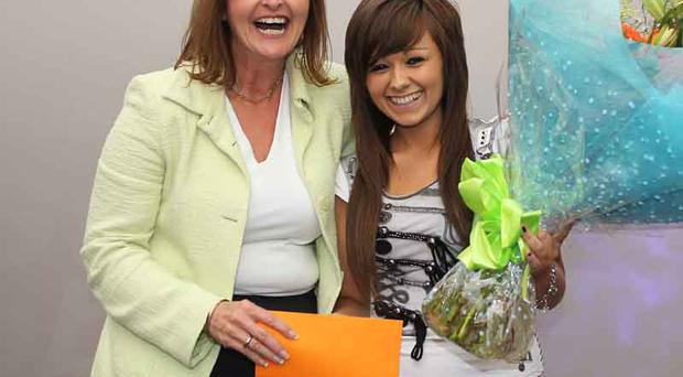 Ali Gayward easyjet Uk commercial manager presenting Jessica Hammond winner of the young Senior section of the City Beat Young Star search with her prize held at the Castle Court Shopping centre Belfast at the weekend also picture Bill Smyth