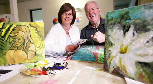 Christine Williamson and Mel Guthrie show off their latest work at the Headway visual arts class
