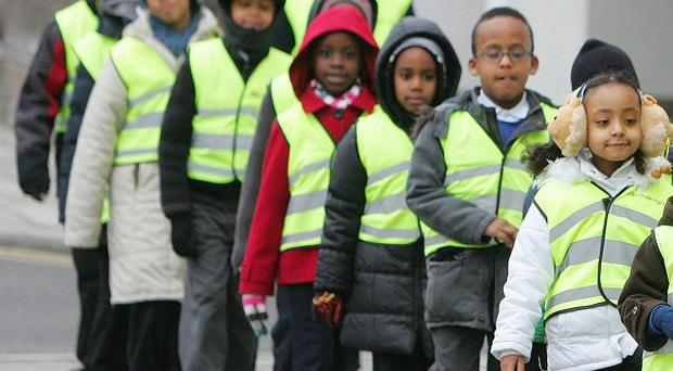Some 80,000 children starting school for the first time will be given a high-visibility vests