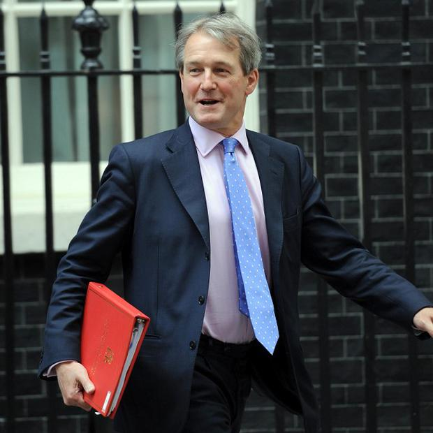 Owen Paterson said the Government was 'sorry' the victims of the Claudy bombing and their families had been denied justice