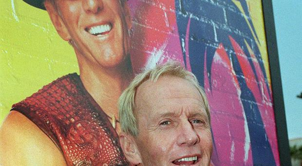 Australian actor Paul Hogan has been barred from leaving Australia until he pays a multimillion dollar tax bill