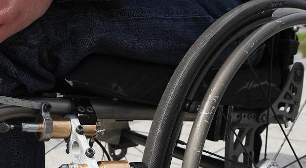 A prison governor had to push an inmate in a wheelchair because wardens refused to do it