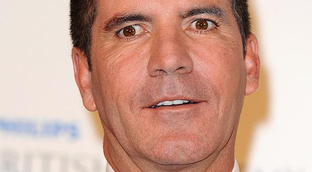 Simon Cowell's X Factor won't use auto-tune in future