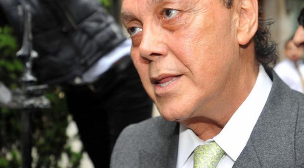 Fugitive tycoon Asil Nadir has flown back to the UK after nearly two decades on the run