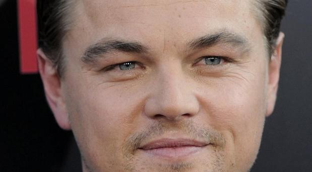 A US judge has ordered a woman to stand trial over Leonardo DiCaprio's wounds (AP)