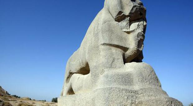 Lost heritage: a damaged statue of a lion in Iraq
