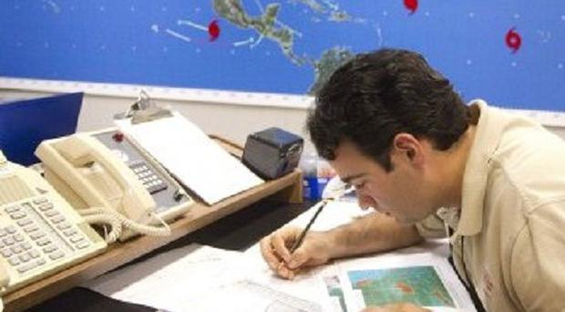 A hurricane specialist plots the movement of Hurricane Danielle at the National Hurricane Centre in Miami