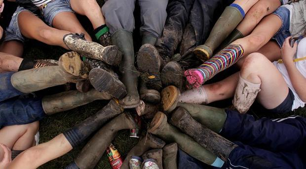 Revellers at the Reading Festival show off their wellies
