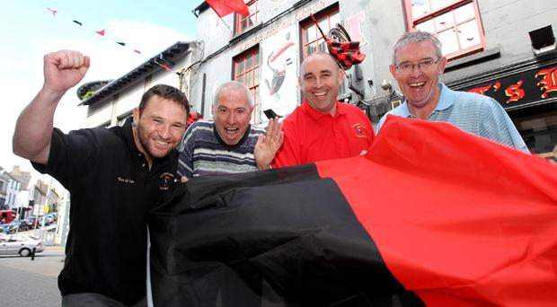 Down fans get ready for their team's All Ireland Football semi-final against Kildare. Thousands are expected to make the journey to Dublin's Croke Park for Sunday's game