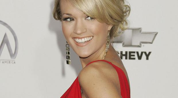 Carrie Underwood will co-host the Country Music Association awards show
