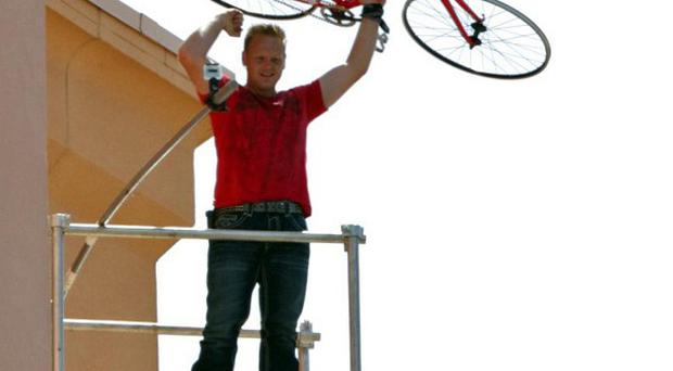 Nik Wallenda, a seventh-generation high-wire daredevil, reacts after finishing his stunt