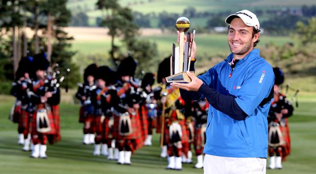 Edoardo Molinari of Italy with the winners trophy after the final round of The Johnnie Walker Championship at Gleneagles. The win earned Molinari a Ryder Cup wild card