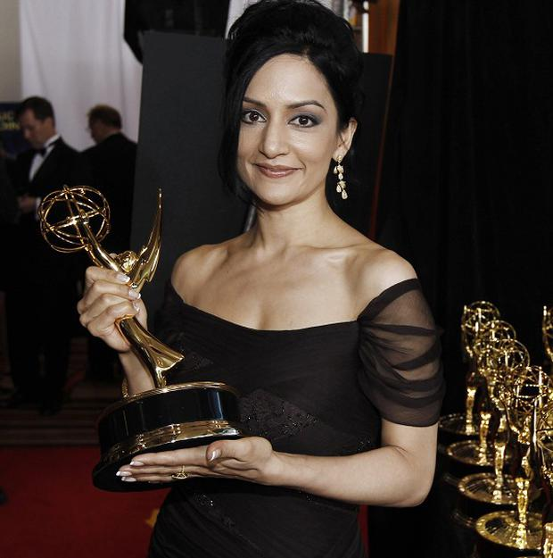 Archie Panjabi collects the award for best supporting actress in The Good Wife