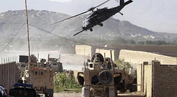 A US Army helicopter takes off carrying soldiers injured in a roadside bombing in Kandahar (AP)