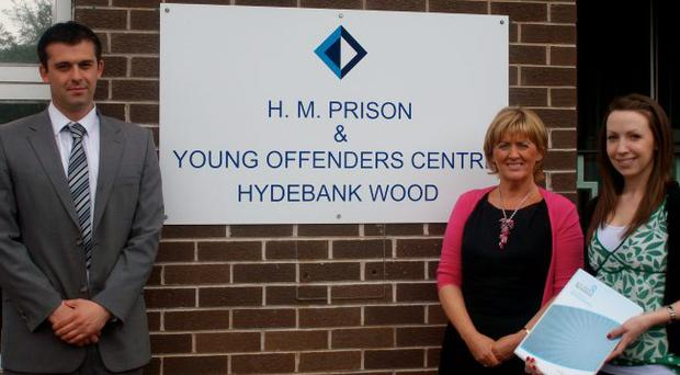 Course tutor Paul Mellon outside Hydebank Young Offenders Centre in Belfast with Alice Quinn, director of North City Business Centre and colleague Aisling Rodgers