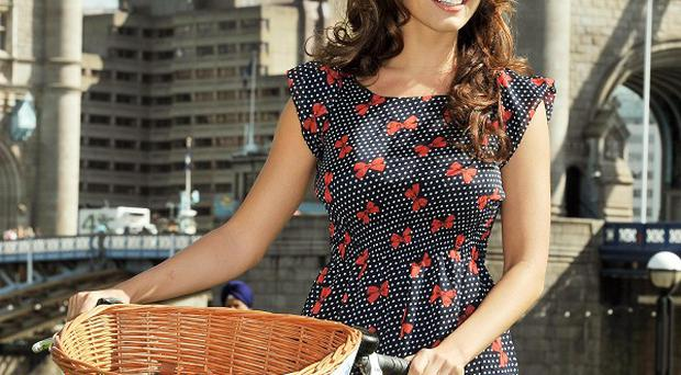 Kelly Brook riding a tandem in central London to promote the London Skyride
