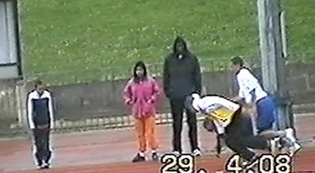 Matthew Thomas, shown here coaching children at an athletics track, was found guilty of defrauding his employers