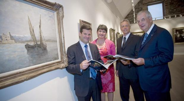 First Minister Peter Robinson and Enterprise Minister Arlene Foster visiting the Ava Gallery at the Clandeboye Estate with Pierre Beaudoin (left), president and chief executive officer of Bombardier, and Laurent Beaudoin (right), chairman of the Bombardier board, during a visit to Northern Ireland by the Bombardier board of directors