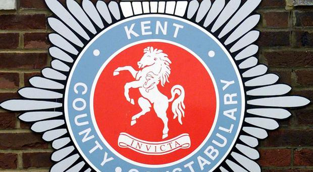 Kent Police said two teenage boys are wanted in connection with a robbery from a security guard in a Lloyds TSB bank