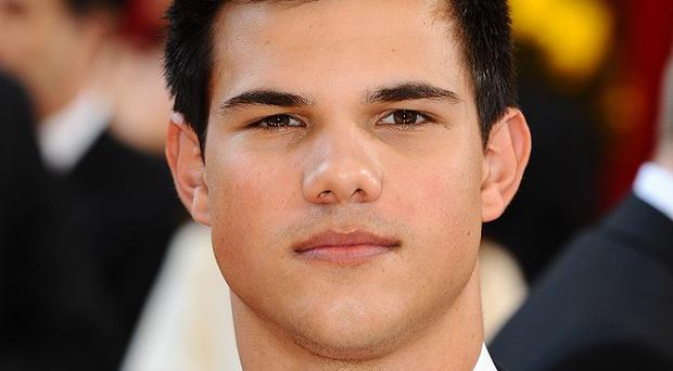 Taylor Lautner has been challenged to a push-up contest