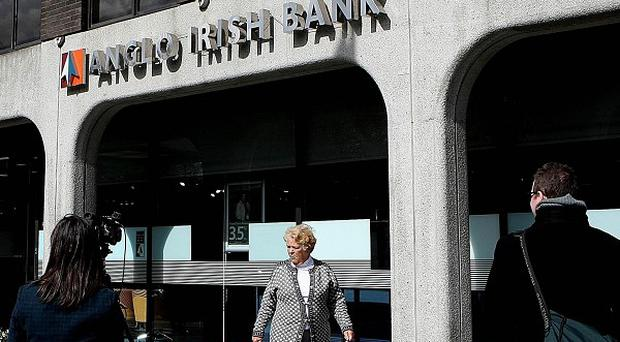 Finance Minister Brian Lenihan is accused of presiding over the most expensive bank bailout in the world
