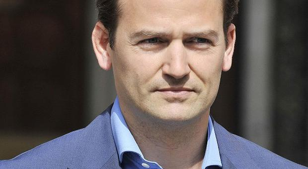 The High Court has refused to ban a book which reveals that Top Gear's The Stig is racing driver Ben Collins