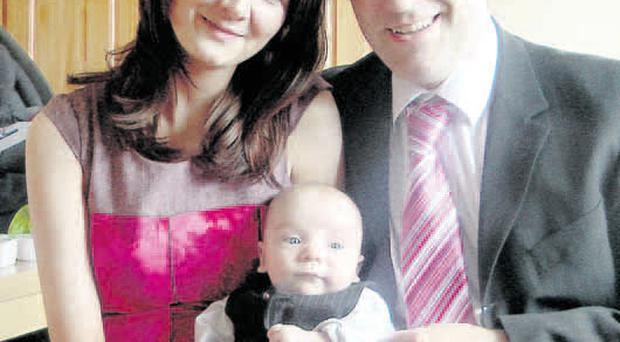 Survivors: Anne and Neill Mullan with their baby son Eoin