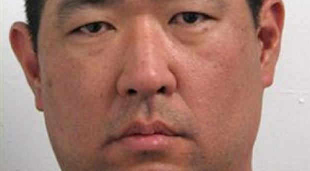 A police mugshot of suspected Discovery Channel hostage taker James J Lee (AP)