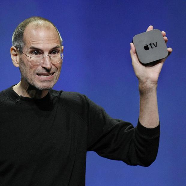 Apple CEO Steve Jobs displays the new Apple TV at a news conference in San Francisco