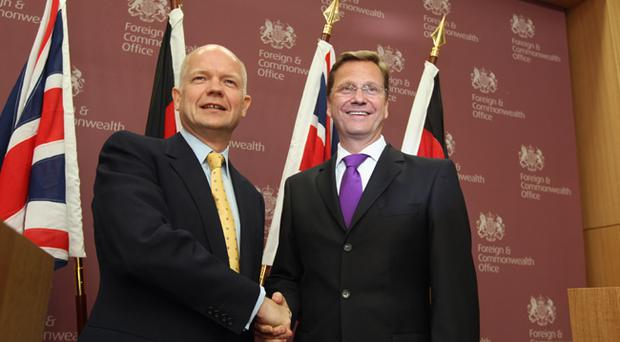 William Hague shakes hands with Guido Westerwelle at a Foreign Office press conference yesterday