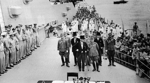 Japanese officials board the USS Missouri for the surrender ceremony in 1945