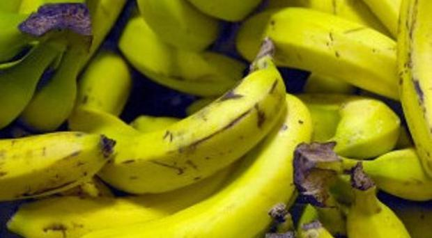 Fyffes fruit company has blamed an overproduction of bananas and rising costs for a 28 percent half-year profits fall