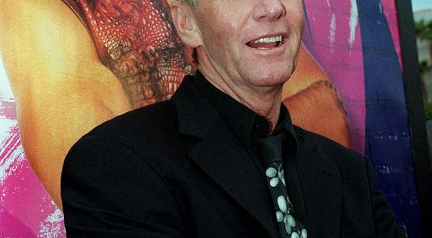 Actor Paul Hogan has been cleared to return home to the US despite a disputed tax bill