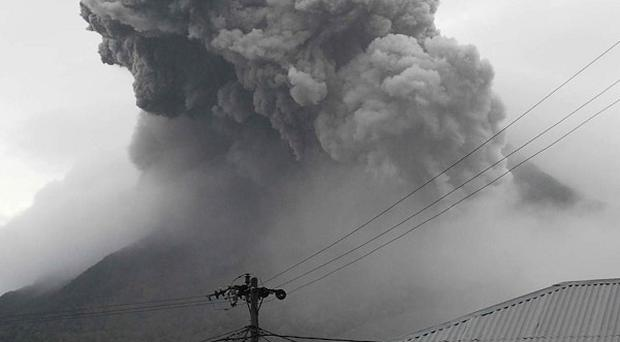 Mount Sinabung spews volcanic materials into the sky as seen from Tanah Karo, North Sumatra, Indonesia (AP)