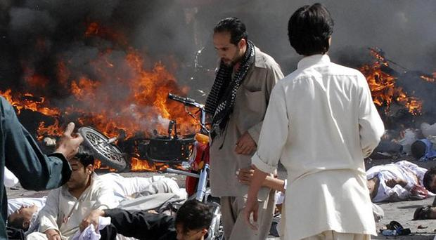A bomb at a religious procession in Pakistan has killed 22 people and injured many others