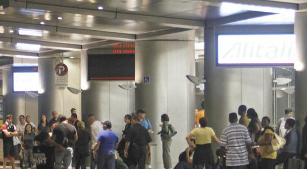 Passengers head out of Miami International Airport during a security alert