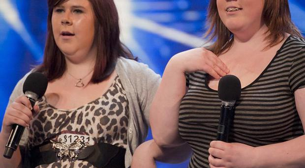 Contestants Abbey and Lisa performing on the ITV programme The X-Factor in Birmingham