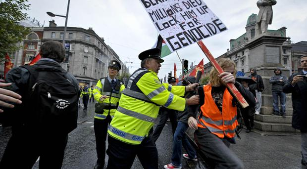 Gardai clash with protesters as former Prime Minister Tony Blair attends his first book signing at Eason's bookstore in Dublin