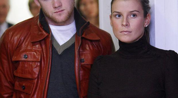 Footballer Wayne Rooney pictured with his wife Coleen.