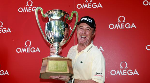 Miguel Angel Jimenez poses with the trophy after winning The Omega European Masters on a score of -21 under par at Crans-Sur-Sierre Golf Club in Crans Montana, Switzerland
