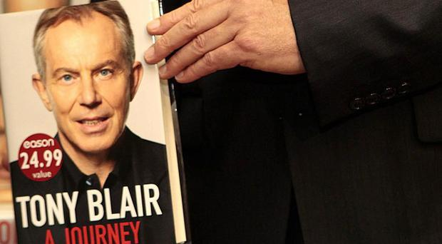 An anti-war campaigner tried to make a citizen's arrest on Tony Blair as he signed books