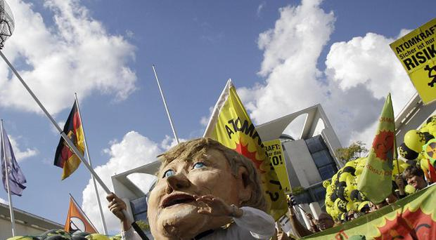 A protester demonstrates against the extending of nuclear power plants' operating time in Berlin