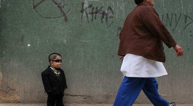 Edward Nino Hernandez, 24, stands outside his home in Bogota, Colombia (AP)