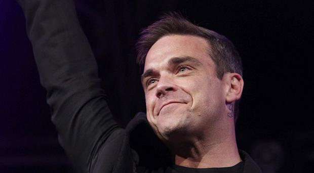 Robbie Williams reminisced about his childhood in Blackpool