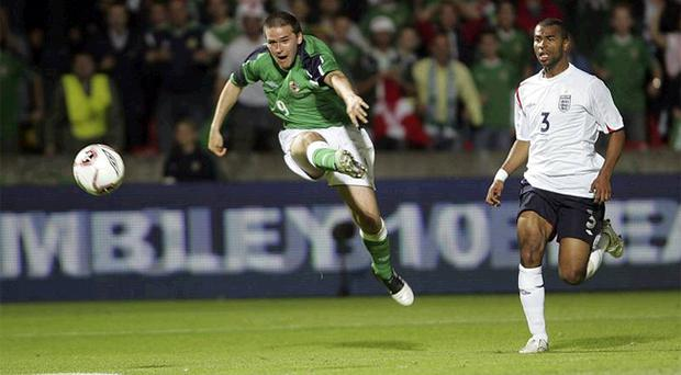 David Healy (left) smashes home one of the most famous goals in Northern Ireland football history leaving Ashley Cole and his England team-mates stunned