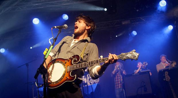 Mumford and Sons performing in the Coors Light Open House Festival Tent in Custom House Square