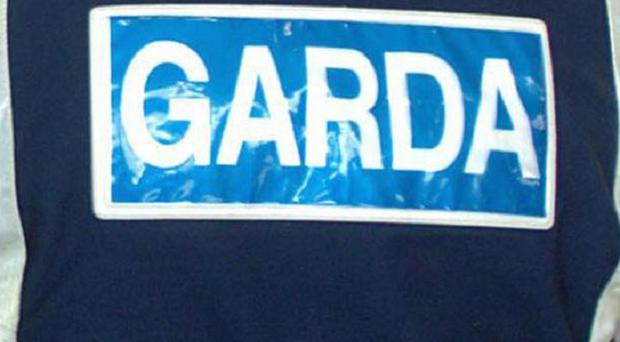 Gardai closed a road after a collision between a van and a motorcycle