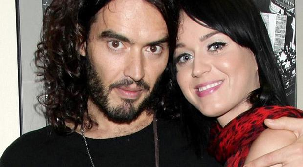 Katy Perry's parents believe that her fiance Russell Brand is on his way to becoming 'a great man of God'