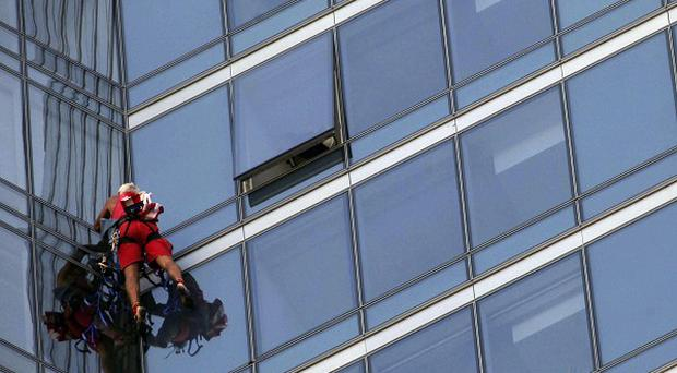 Dan Goodwin, aka Spider Dan, makes his way to the top of the Millennium Tower in San Francisco (AP)